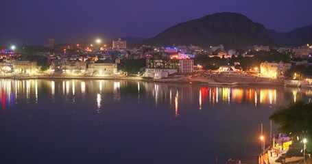 Wall Mural - Night view of famous indian hinduism pilgrimage town sacred holy hindu religious city Pushkar with Pushkar ghats. Rajasthan, India. Horizontal pan