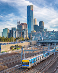 MELBOURNE, VICTORIA/AUSTRALIA May 26: The many highrise buildings of southbank in the city of Melbourne with a Metro train in the foreground in the late afternoon light on May 26th, 2018.
