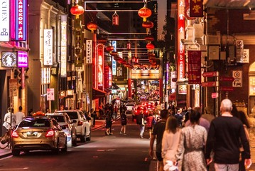 Melbourne, Victoria, Australia, March 7th 2019: The many signs, lights and lanterns in the chinatown area in the centre of Melbourne in the early evening.