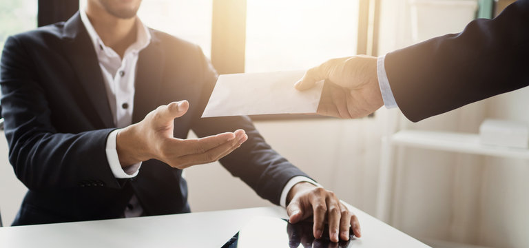 close up hand of employee receive bonus from manager