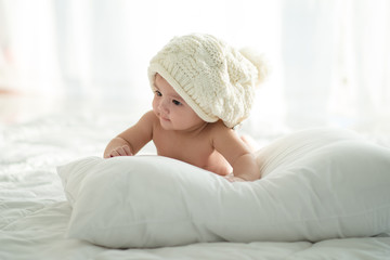 baby on the bed.