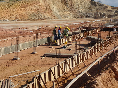 Building ground beam under construction using temporary timber plywood at the site. Reinforced by the reinforcement steel to strengthen the structure.