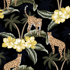 Cheetah, yellow hibiscus flowers and tropical palm trees floral black background seamless pattern. Exotic jungle wallpaper.