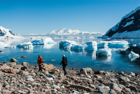 Tourists walking on Antarctic beach, Neko Harbor, Antarctic Peninsula