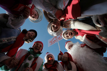 People dressed as Father Frost, Snow Maiden and other characters take part in a parade to celebrate the upcoming Christmas and New Year in Yalta