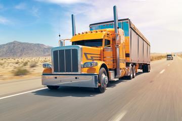 big american orange truck on the speed way