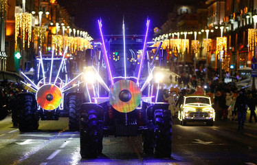 Illuminated Belarusian tractors are seen during  Father Frost, Snow Maiden and other characters march in central Minsk