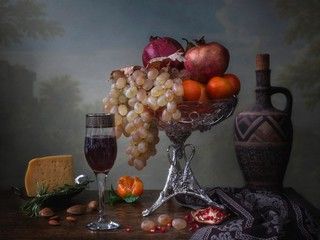 Still life with glass of wine and grapes on wooden background