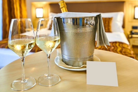 Gift in the hotel room, A bottle of champagne and wine glasses in the hotel room, free space for the welcome messagewelcome message