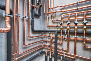 Plumbing service. copper pipeline of a heating system in boiler room Fotoväggar