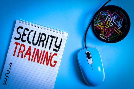 Word writing text Security Training. Business photo showcasing providing security awareness training for end users Blank notebook and clips with computer mouse placed above pastel backdrop