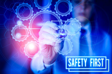 Writing note showing Safety First. Business concept for used to say that the most important thing is to be safe Picture photo network scheme with modern smart device