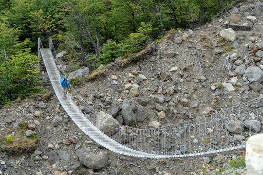 Hiker on Long Suspension Bridge