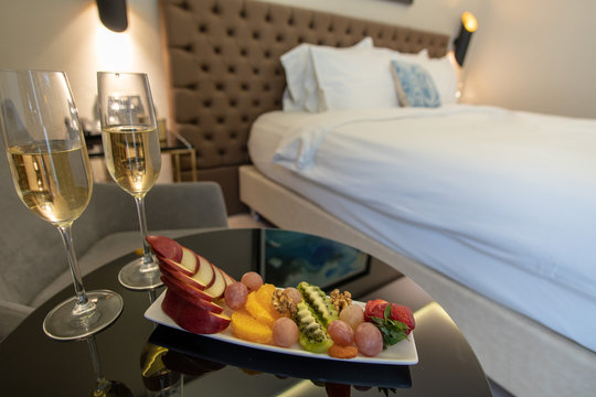 champagne glasses and fruit salad in hotel room