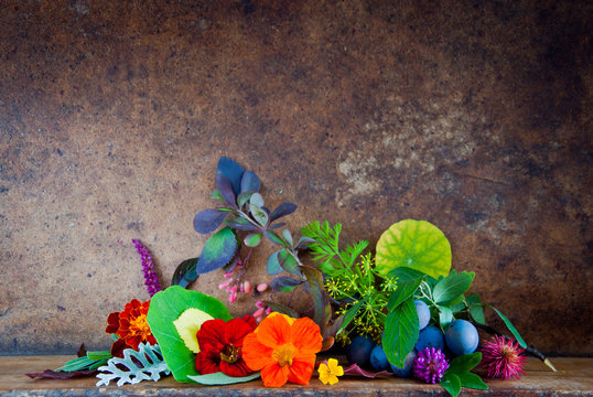 Autumn Leaves, Flowers, Berries on a wooden background