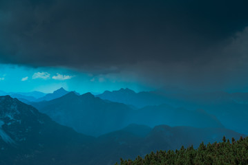 Photo sur Plexiglas Bleu vert Dark storm clouds and rain come often unexpectedly out of the blue sky weather in high mountains, that is dangerous for unprepared hiking tourists. Austrian Dachstein Alps, UNESCO Salzkammergut Region