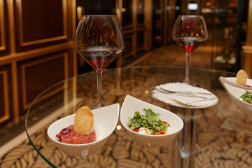 Steak tartare with froth and Caprese salad