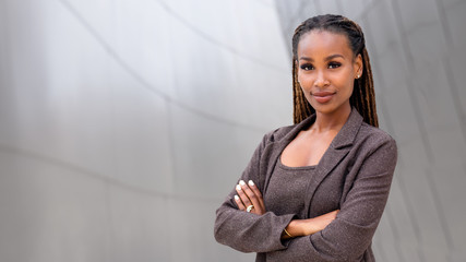 Banner of African American female company leader CEO boss executive standing confident with ambition and pride, at financial
