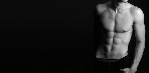 Muscular fit male body , black and white photo