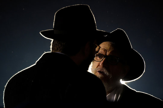 Two men talk during a gathering at Grand Army Plaza in solidarity with the victims after an assailant stabbed five people attending a party at an Hasidic rabbi's home in Monsey, N.Y., on December 28, 2019, while they were celebrating Hanukkah in New York