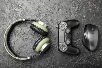 Modern gaming accessories on grunge background