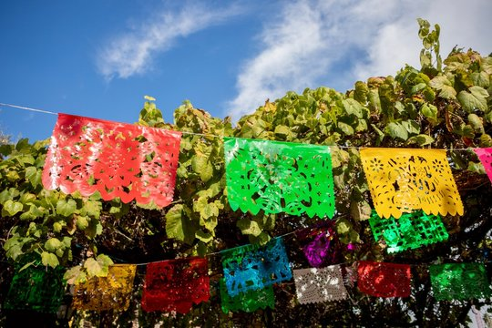 Papel picado flags against blue sky. Taken on Olvera Street in Los Angeles, California USA
