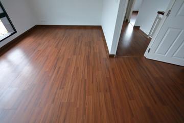 brown wood laminate floor in residential house