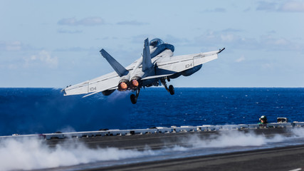 USS Ronald Reagan operates off the coast of Rockhampton, Australia during Exercise Talisman Sabre.  A F/A-18 Super Hornet is catapulted off the deck Fototapete