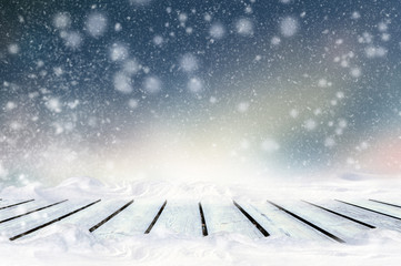Wall Mural - Greeting winter blurred background with wooden table and snowflakes