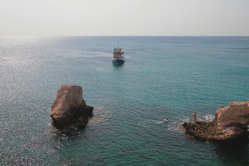 Rocks and pleasure boat in sea. Agia Napa, Cyprus