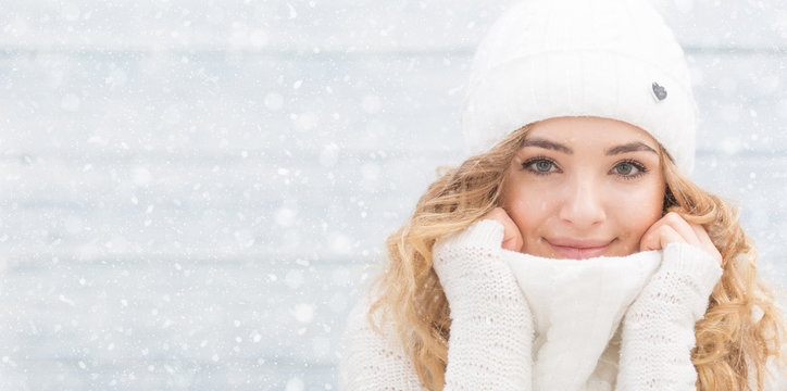 Portrait of young beautiful woman in winter clothes