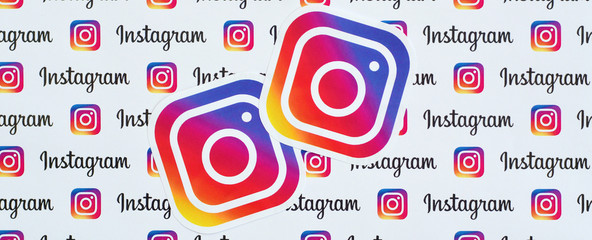 Instagram pattern printed on paper with small instagram logos and inscriptions. Instagram is American photo and video-sharing social networking service owned by Facebook