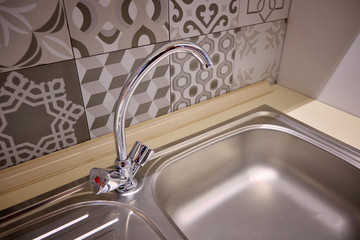 Brand new sink and chrome water faucet