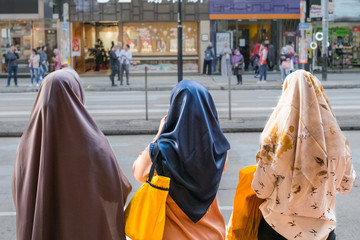 Three muslim women or girls wearing hardscarf / hijab