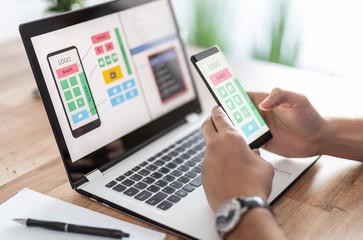 Designers drawing website ux app development.