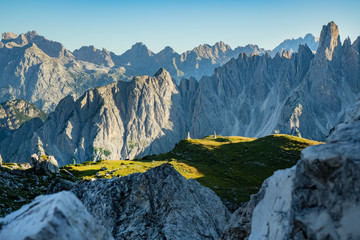 Panoramic view of famous Dolomites mountain peaks glowing in beautiful golden evening light at...
