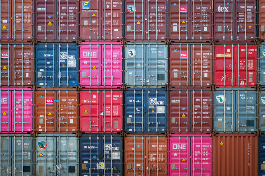 Stacked shipping container on freight harbour logistics centre in Hong Kong, November, 2019