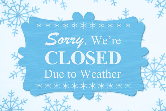 Sorry We're Closed Due to Weather message on a wood sign