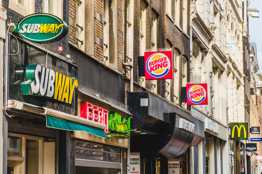 Fastfood chain brand logos of Subway, Mcdonald and Burger King in City center of Amsterdam , Netherland, march, 2019