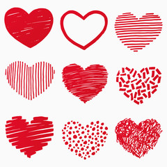 Red hearts in hand drawn style. Grunge heart shape set isolated on white background. Symbol of love. Doodle element for Valentines Day or wedding design. Vector illustration