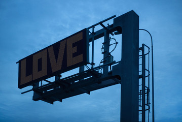 """The inscription """"""""Love"""""""" on a large billboard"""