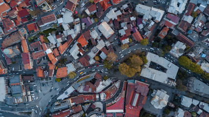 Panoramic Drone View Of a cozy town full of both old and new roofs