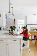 Teen Lifestyle Image of girl Doing Artwork in Kitchen