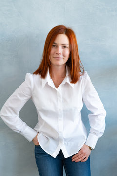 Image of happy young business woman posing isolated over wall background.