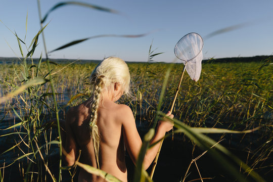 Preteen girl with butterfly net