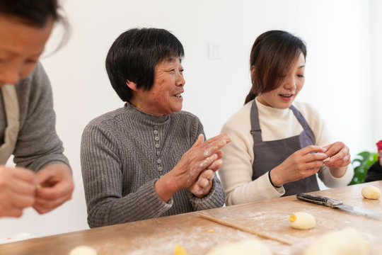 happy asian family making Chinese bread in home
