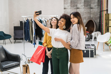 Friends taking a selfie in a store during shopping