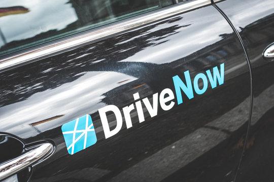 """DriveNow"" logo on a car door in- Berlin, Germany - June 2018"