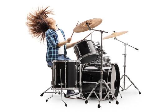 Female drummer throwing hair back