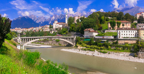 Travel in northern Italy - beautiful Belluno town surrounded by impressive Dolomite mountains